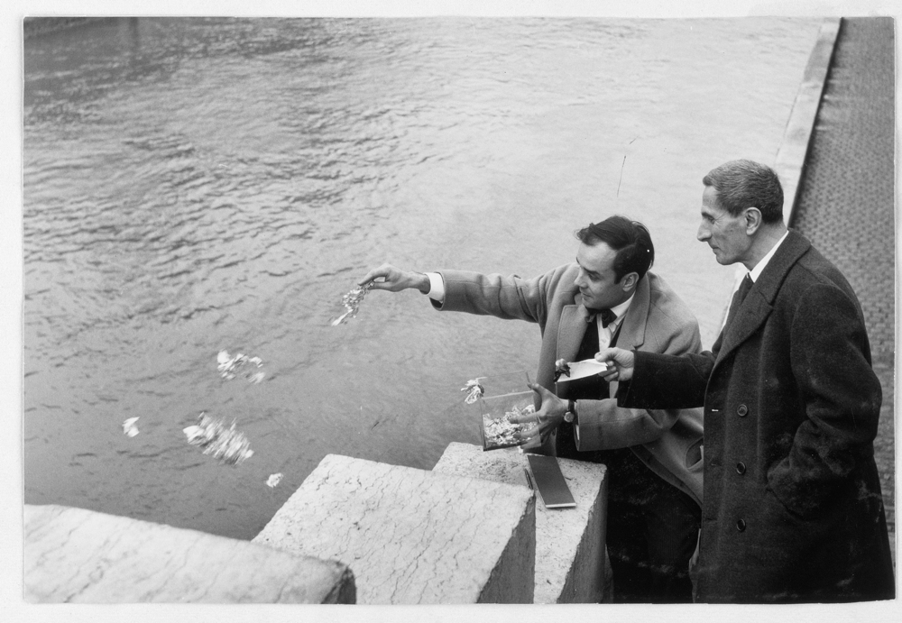 Yves Klein and Dino Buzzati engaged in the ritual transfer of immateriality, 1962