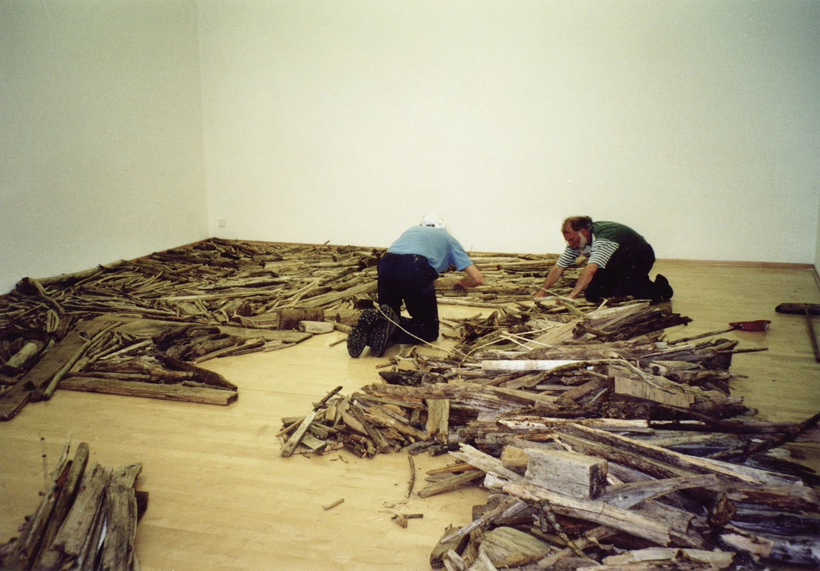 Gerard Vermeulen and Richard Long installing the work Rhine Driftwood for the exhibition Richard Long, Museum Kurhaus Kleve - photograph by PF, June 2001